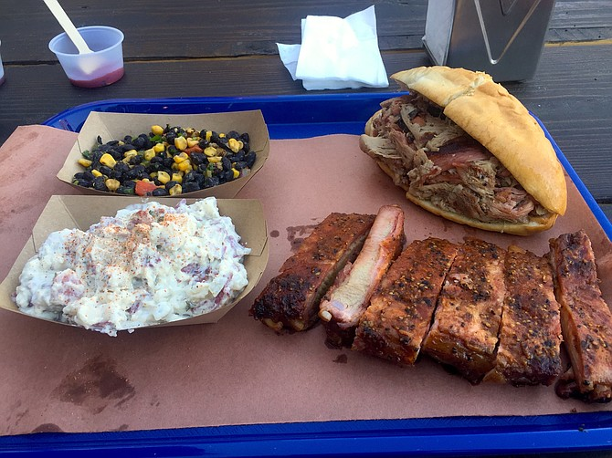 Pulled pork sandwich, some sides, and ribs