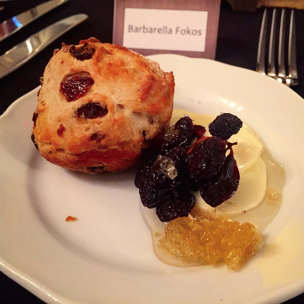 A dense and flavorful scone, served with dried plums, honey, and butter, all meant to bring out the notes in the whiskey