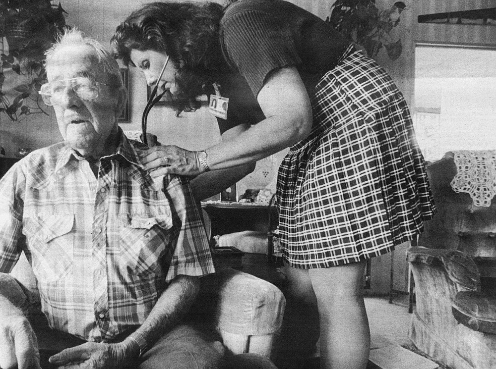 Colleen Dodge taking vitals of Harley Davison at his home