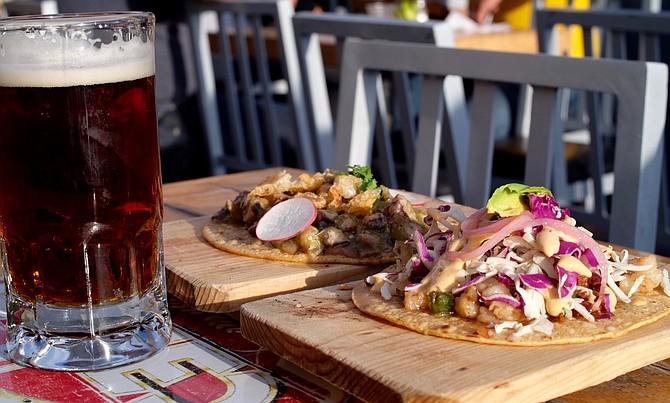"""Indio beer, shrimp taco, and octopus in salsa verde """"Alga Bien"""" taco."""