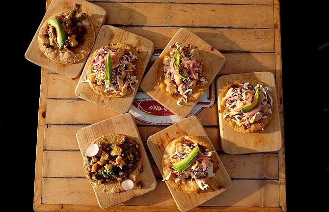 Top view of seafood tacos at Alga Bien