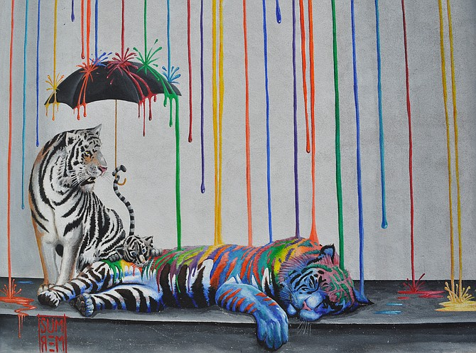 Michael Summers' 2013 mural Catnap — on the wall outside Witch Creek Winery — is the inspiration for the name Sleeping Tiger Coffee.