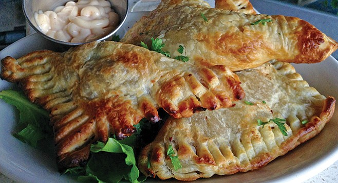 Eat these Louisiana meat pies for their sausage meat, but mostly for their wicked pastry
