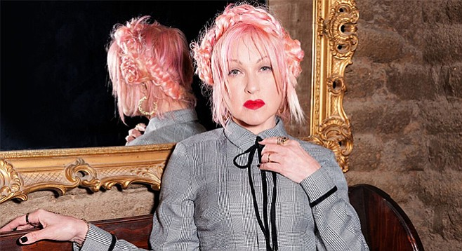 After taking turns as a singer of new wave, R&B;, electronica, and classics, Lauper lends her pipes to country on this year's Detour. - Image by Chapman Baehler