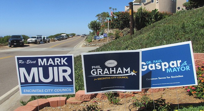 in an uncommon show of political alignment, almost every home has yard signs posted for the slate of three candidates.