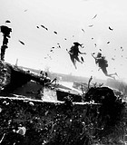Diving buddies share a moment of magic, hovering over the wreck of an American battleship.