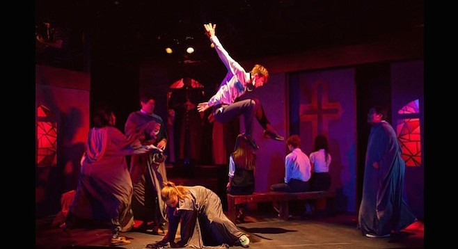 Michael Mizerany (center) flying right side up in Bare: A Pop Opera at Diversionary Theatre