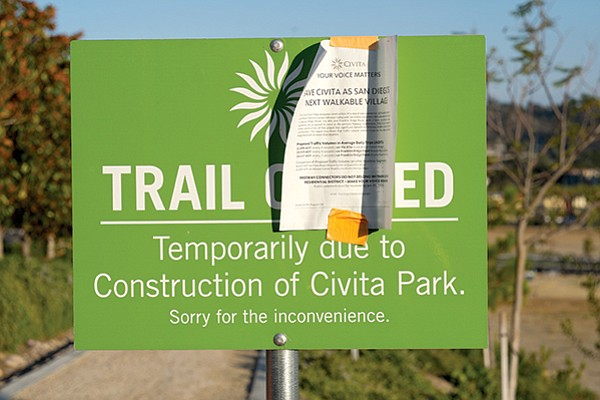 """""""Save Civita"""" flyer posted on walking trail closure sign"""