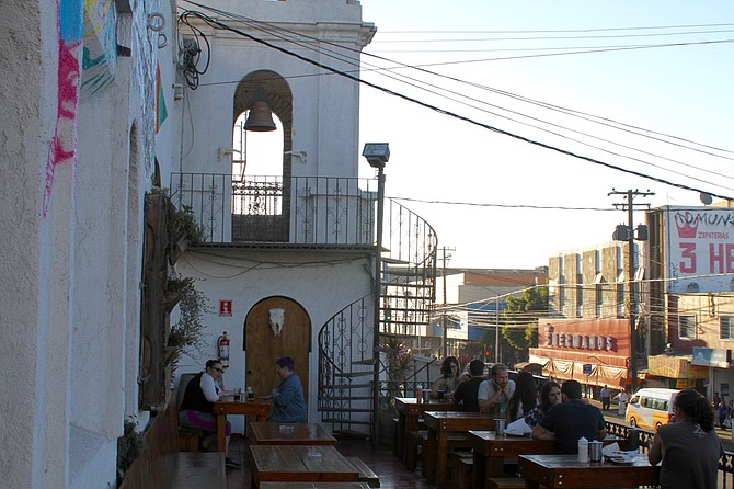Mamut's balcony used to belong to the Foreign Club hotel, overlooking Calle Tercera. A steeple was common in old hotels.