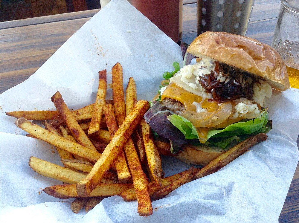 Three-cheese burger with caramelized onions