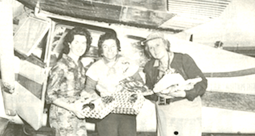 Aileen Mellott, Lea Hanlon, Polly Ross prepare to deliver Christmas gifts, 1961