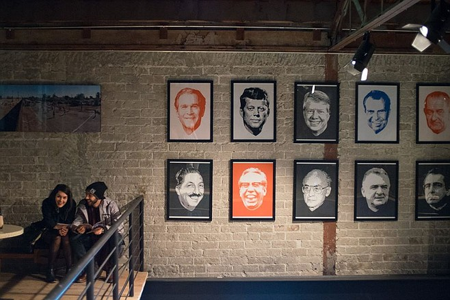Framed portraits of Mexican and American presidents on the walls of Cine Tonalá