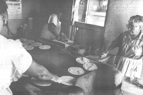 Six or eight women worked in there all day, sweating and yelling over the sound of a radio.
