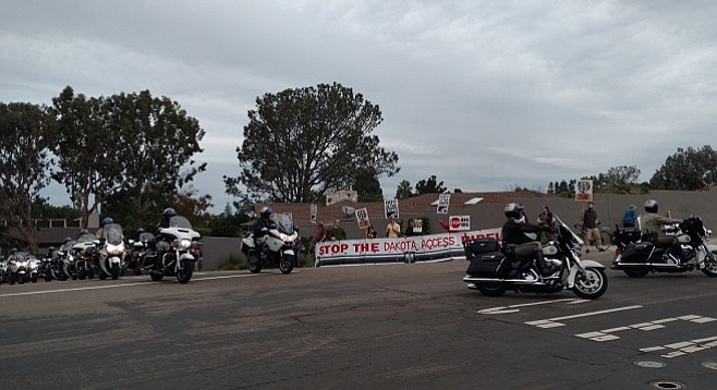 Protesters stood on La Jolla Shores Drive as police prepared for the arrival of President Obama's motorcade