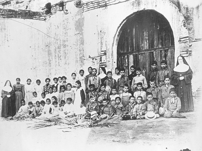 Indian children with nun at San Diego Mission