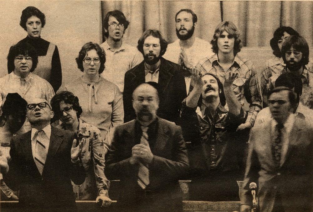 Pastor Ken Pagaard (center, wearing tie)