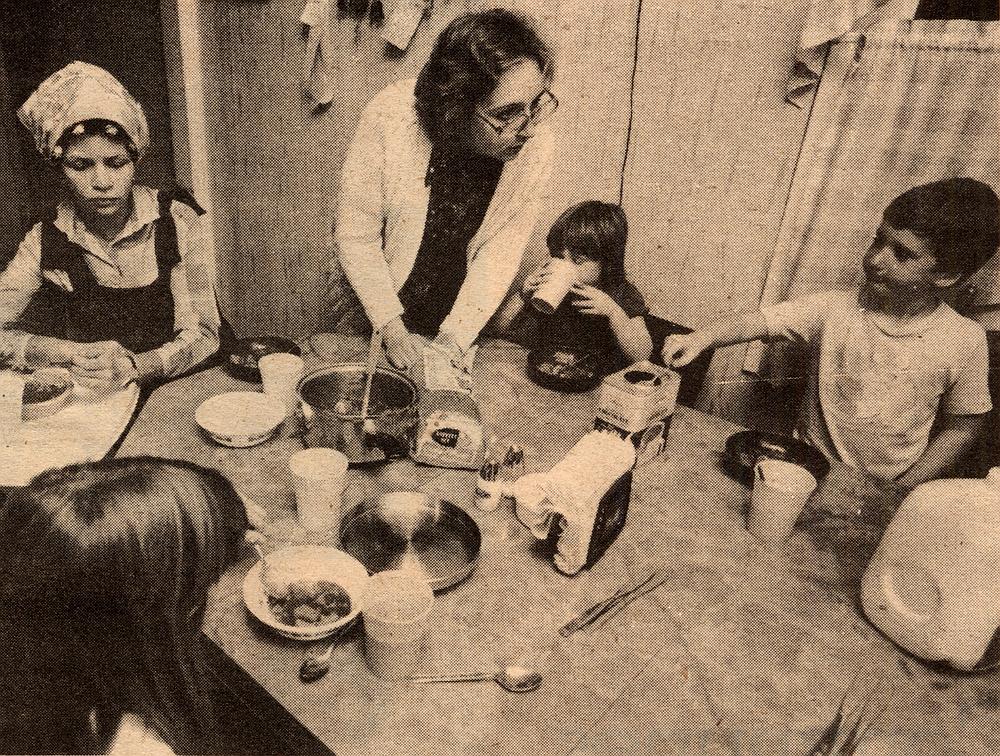 Georgia and Barb feeding children