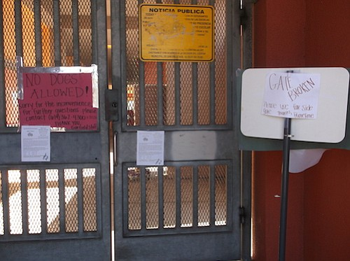 """Gate broken"" sign at Garfield Elementary suggests using ""far side gate"""