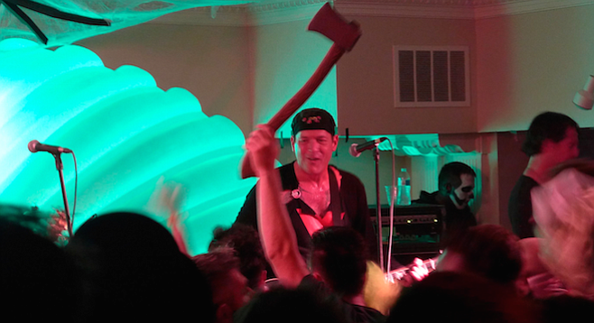 Throughout Rocket from the Crypt's set a fan near the front hoisted an axe above the crowd.