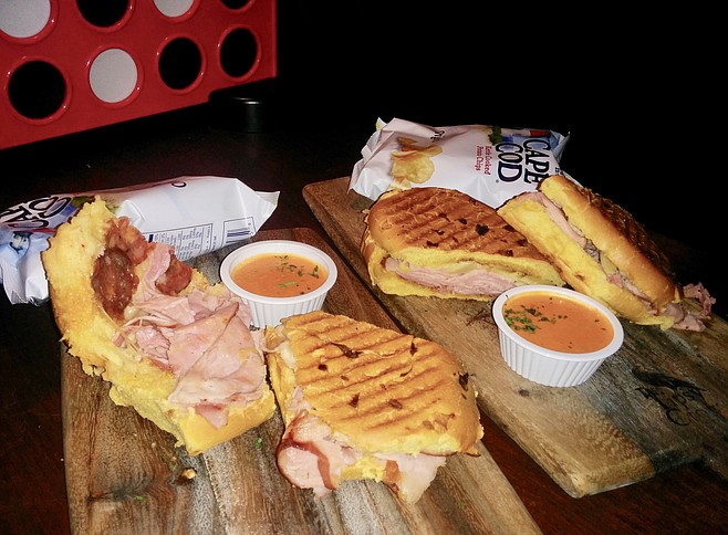 Cubano to the left, Pacific Press to the right, almost the same sandwich
