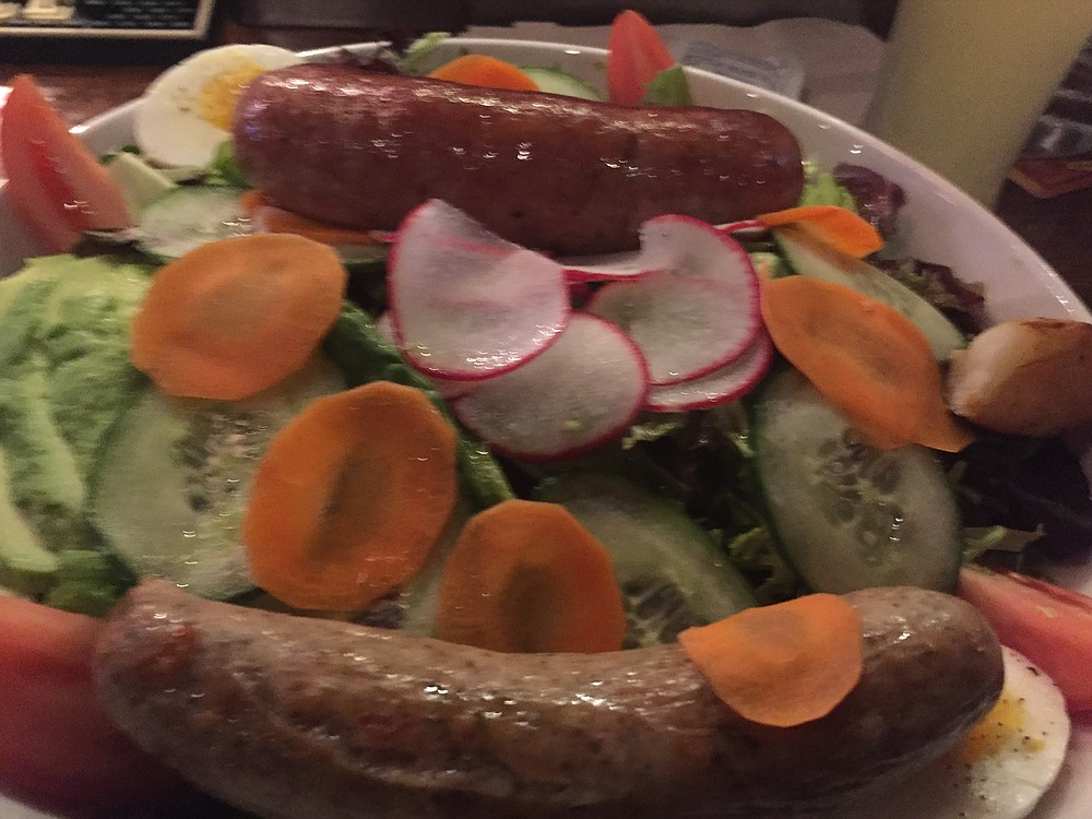 A fresh green salad with homemade andouille sausage (top) and spicy bratwurst with gouda sausage (bottom)