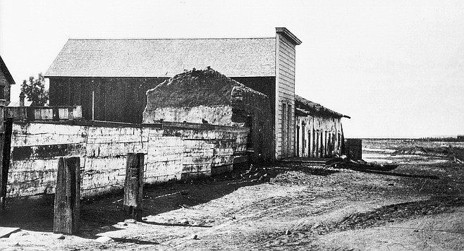 The first official schoolhouse — in District I — was the Fitch-Snook house on Calhoun Street. Rent was $14 per month. Class-work began August 1, 1854.