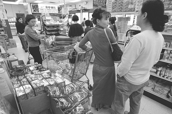 First Korean Market, Kearny Mesa. It is warm and stuffy inside, vast and yet claustrophobic.