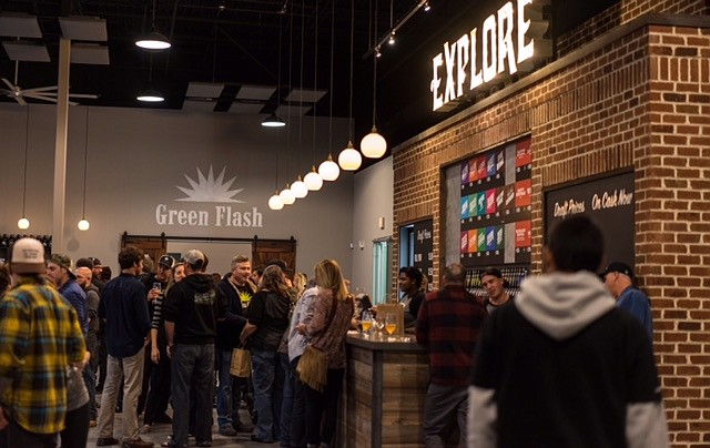 Visitors gather for the East Coast rendition of Green Flash's annual Treasure Chest fundraiser, on the opening day of its Virginia Beach brewery and tasting room.