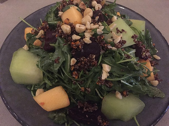 The Melon and Roasted Beet Salad has lots of arugula as well as chopped hazelnuts and red quinoa in a white balsamic vinaigrette.