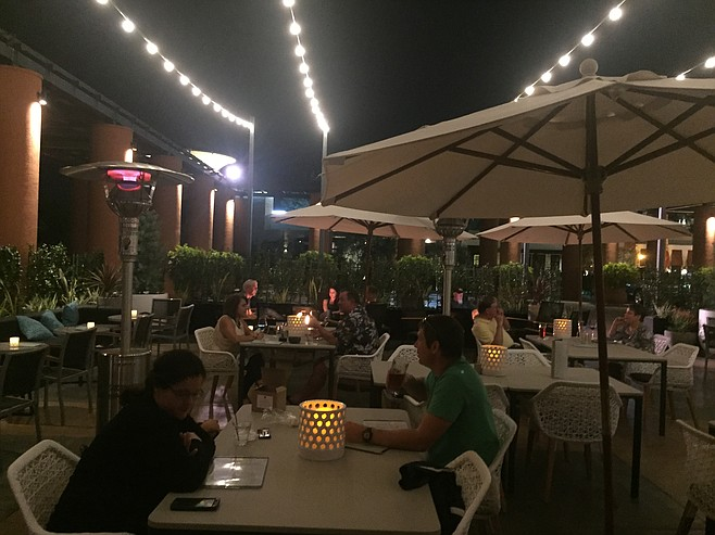 The patio of Drift at night.