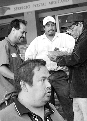 """Javier Mejía Quezada (foreground): """"We don't charge. We work for whatever they want to give us. Sometimes they give us a quarter, sometimes just two pesos. Sometimes it's nothing, and that's fine."""""""