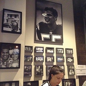 On the wall: memories of family and owner's close friend, Junior Seau.