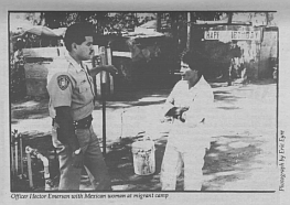 """What do you say?"""" Officer Hector Emerson calls over to a group of Guatemalan men waiting for work outside a small shopping center in Fairbanks Ranch."""