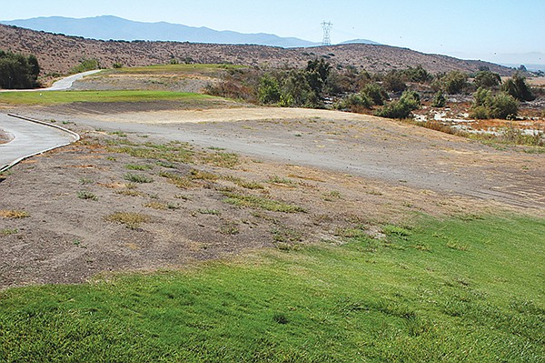 With a dried up lakebed to the right this hole features two forced carries.