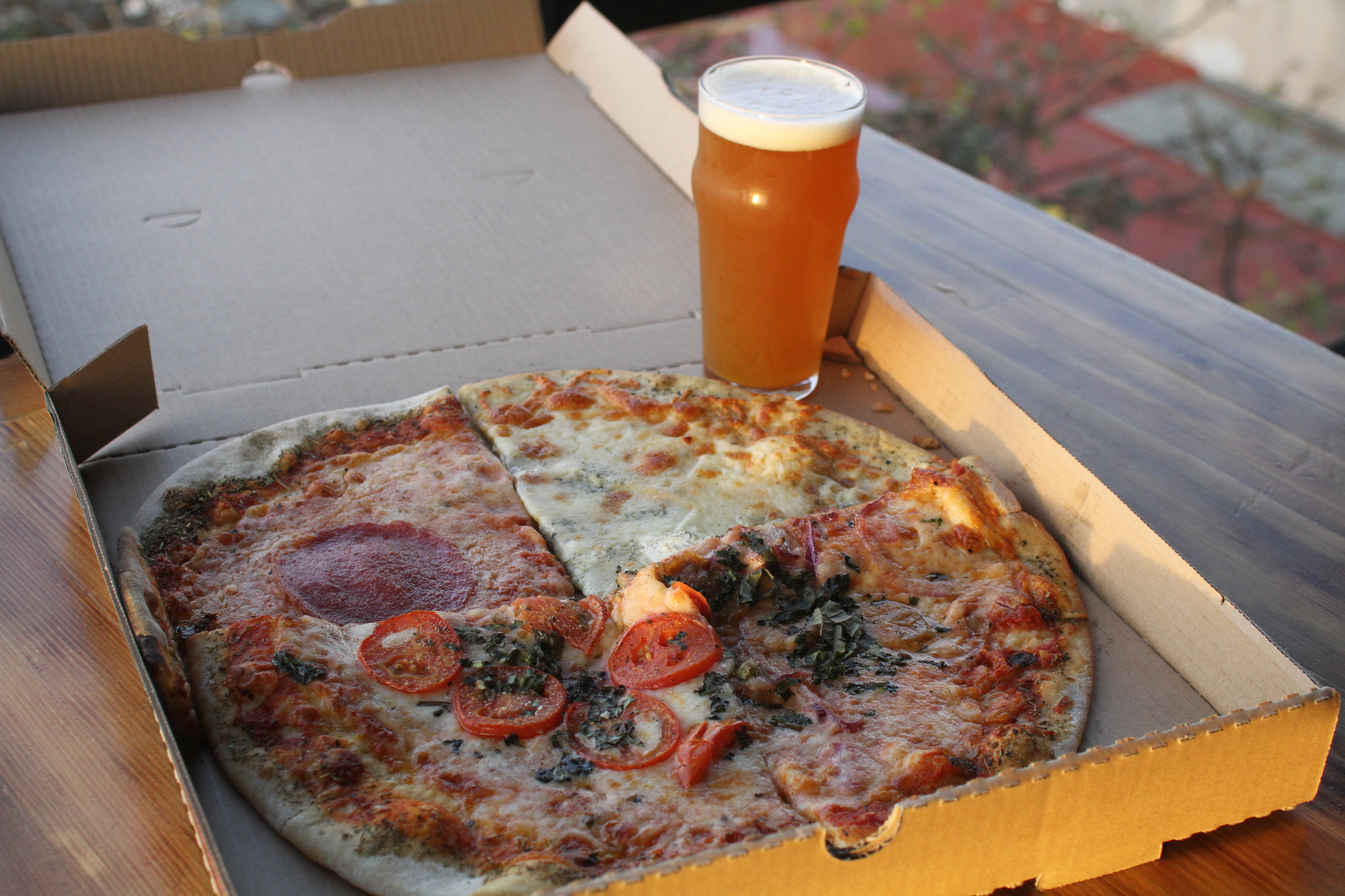 All four slices with a pint of Penthouse IPA at Norte Brewing Co.
