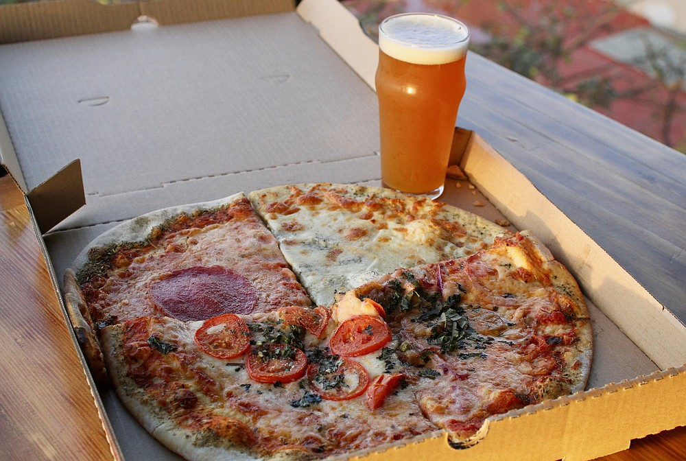 All four slices of Volo with a Penthouse IPA at Norte Brewing Co.