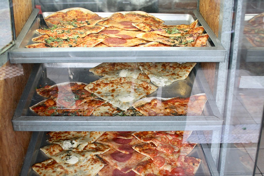 Glass case pizza display on an early Wednesday at Al Volo