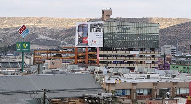 Downtown Tijuana billboard announcing the upcoming buses