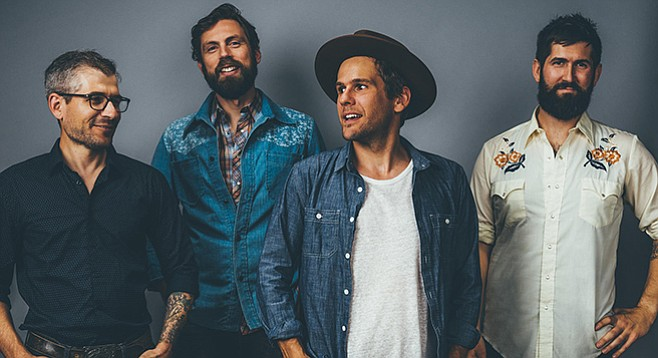 The four Steel Wheels gather in true old-style around a single microphone to belt out traditional harmonies.