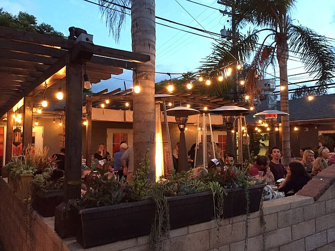 Outdoor dining at Le Papagayo, with live music nightly. But you'd better think about making reservations.