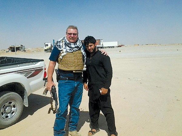 Dave Sossaman and Sher Mohammad Haidari in Afghanistan