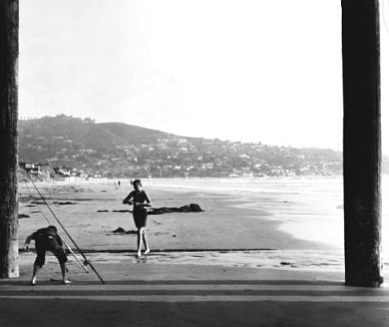 """Surf fishermen under Scripps pier, 1950s. """"Miller has a trick of throwing in little stories or digressions, often whimsical in a Saroyanesque manner."""""""