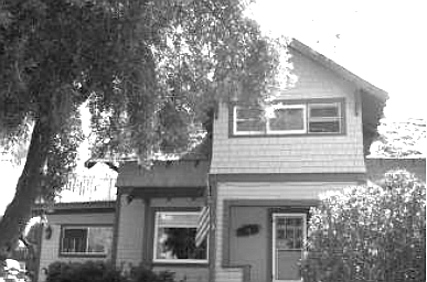 "The La Mesa family home. ""I grew up, in this nifty two-story house built about 1900 on an acre of land."""