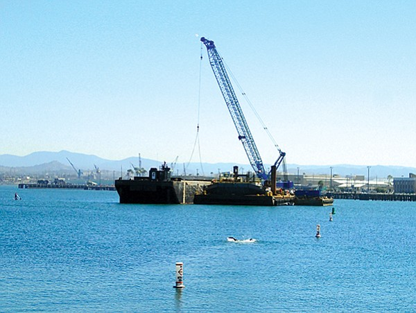Dredging barge in the middle of Glorietta Bay, where it was kept during the day before being moved over to the  piers at night where the dredging took place.
