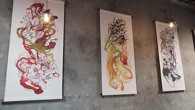 The artwork at Newtopia Cyder represents its flagship cider flavors.