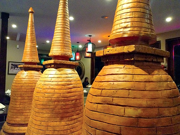 The restaurant's three chedi, mock-ups of the structures built over burial sites of revered Buddhist monks