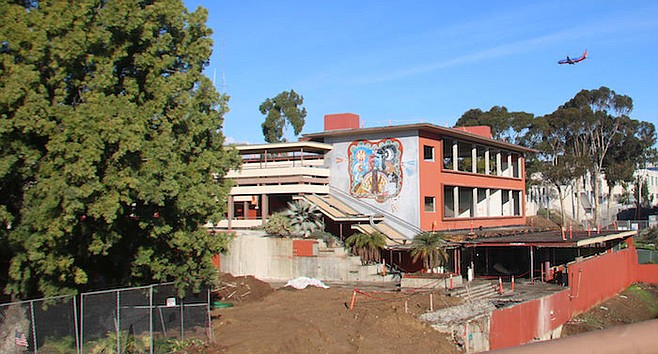 The mural above the old bookstore and the large pepper tree by the A Building will remain.