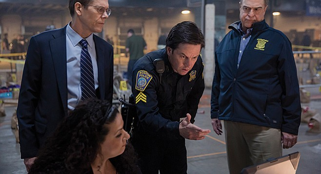 Patriots Day: John Goodman looks skeptical about the stopping power of Mark Wahlberg's finger-gun; Kevin Bacon appears to be withholding judgment.