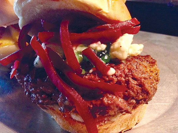 """Bare Lil Lamb,"" the ultimate Kiwi burger. Green jewel is the essential mint jelly."
