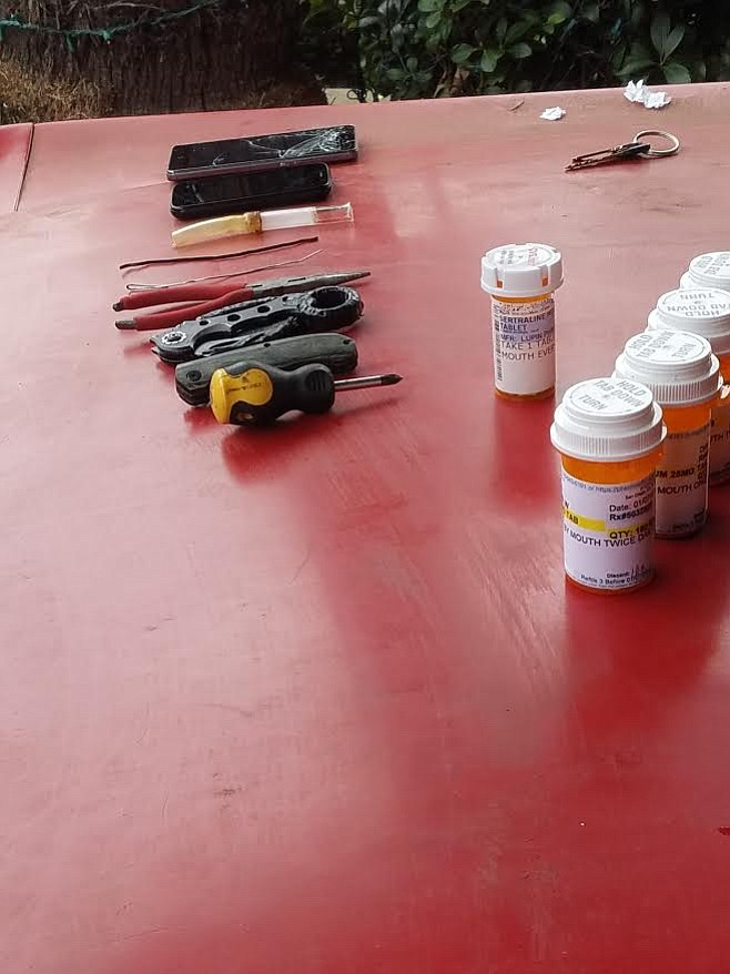 Pills, pipes, and tools were among the objects found on the suspect.